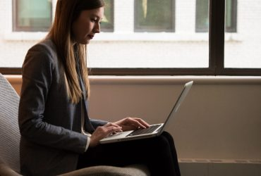 Telework woman-sits-and-use-laptop-computer-near-window-1181542